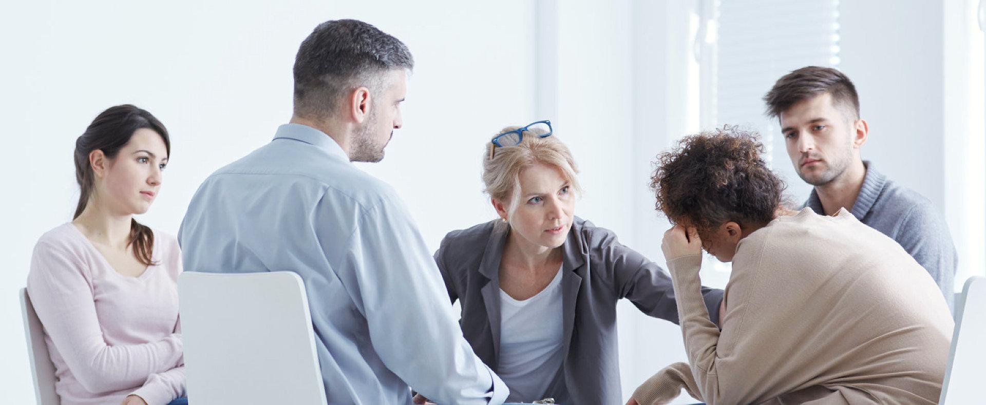 five people talking